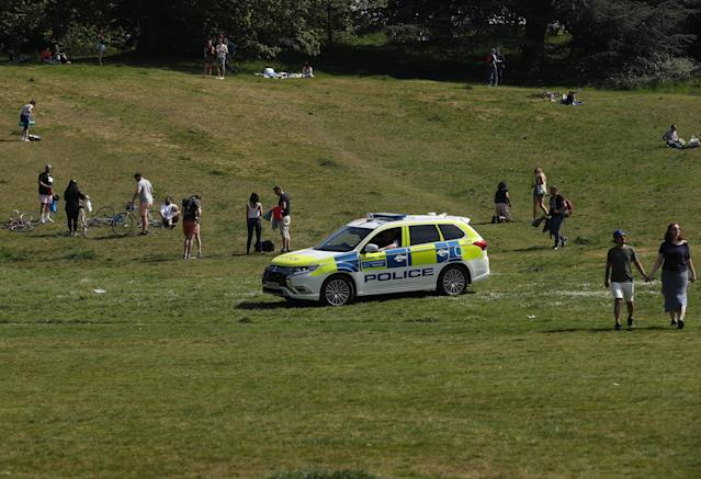 People in England can now visit a local park to relax, but guidance on who they can meet has been labelled unclear. (Yui Mok/PA Images via Getty Images)