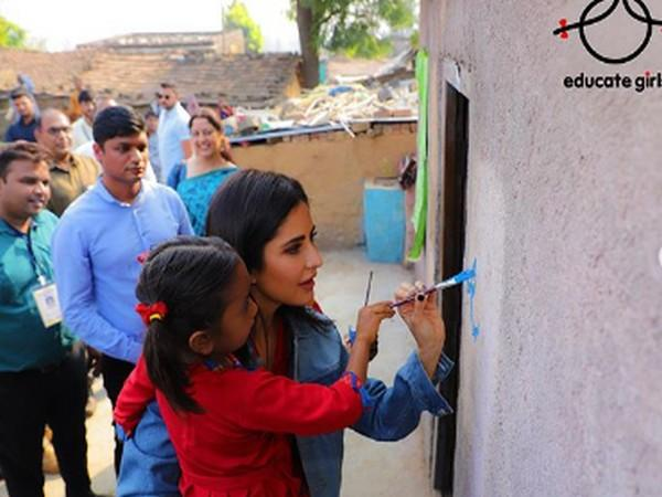 Actor Katrina Kaif painting with a child (Image Source: Instagram)