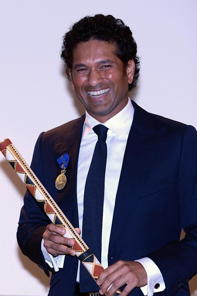 "Indian cricketer Sachin Tendulkar looks on after being conferred with the membership of The Order of Australia by Simon Crean, Australian Minister for Regional Australia, Regional Development and Local Government, during a ceremony in Mumbai on November 6, 2012. India's record-breaking batsman Sachin Tendulkar on November 6 was conferred with membership of the Order of Australia. Australian Prime Minister Julia Gillard, who announced Tendulkar's membership to the Order during a three-day state visit to India last month, told reporters that Tendulkar deserved the ""special honour"" because he was a ""very special cricketer"". AFP PHOTO/ INDRANIL MUKHERJEE"