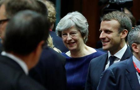 British Prime Minister Theresa May (L) and French President Emmanuel Macron arrive at a EU summit in Brussels, Belgium October 19, 2017. REUTERS/Yves Herman