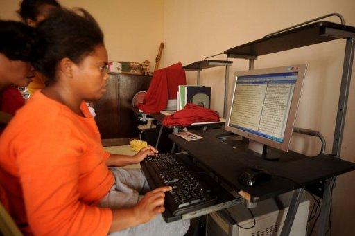 A girl uses a computer to translate the Bible into her mother tongue, Ayta Magindi, one of several dozen endangered languages in the Philippines. From the start of the new academic year in June, 12 of the most widely used languages will replace English and Filipino as the language of instruction from kindergarten to third grade