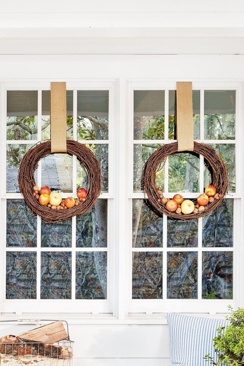 <p>This festive decoration couldn't be simpler. Just add faux apples to the bottom of a grapevine wreath (or two!), then hang and admire. </p>