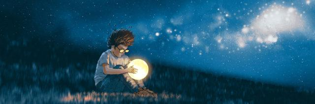 Boy with a little moon in his hands.