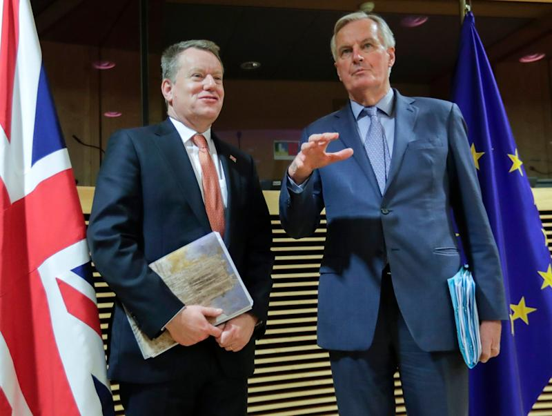 David Frost has called on EU negotiator Michel Barnier (right) to drop his 'ideological' approach (AP)