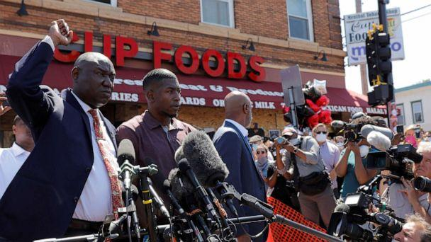 PHOTO: Civil rights attorney Ben Crump gestures next to George Floyd's son, Quincy Mason Floyd, as they visit the site where George Floyd was taken into police custody, in Minneapolis, June 3, 2020. (Lucas Jackson/Reuters)