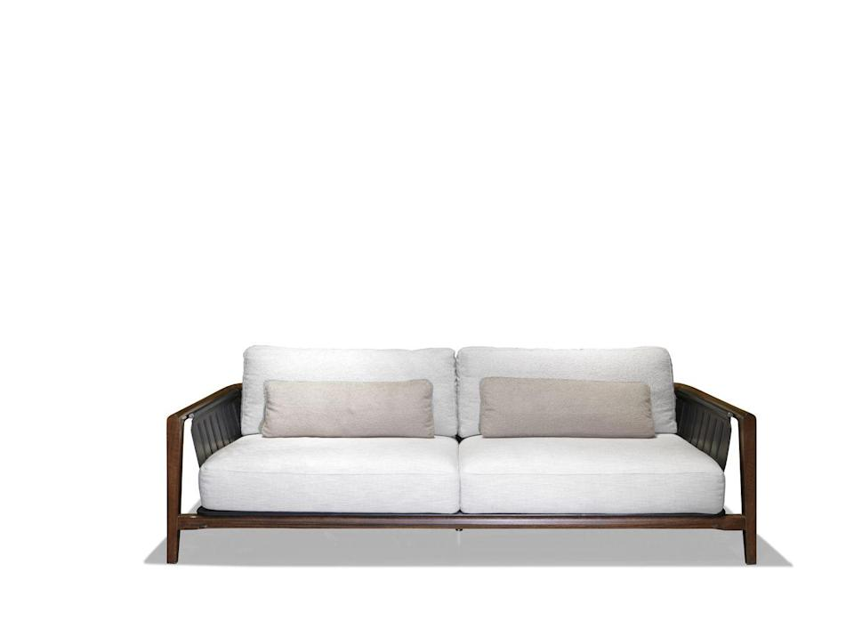 "<p>Just as comfortable outdoors as it is indoors, this sofa by designers Roberto Tapinassi and Maurizio Manzoni features a solid-wood frame and leather straps. Its natural materials complement gardens and homes filled with house plants. £10,560, <a href=""https://www.visionnaire-home.com/home-philosophy/dehors/green-life"" rel=""nofollow noopener"" target=""_blank"" data-ylk=""slk:visionnaire-home.com"" class=""link rapid-noclick-resp"">visionnaire-home.com</a></p>"