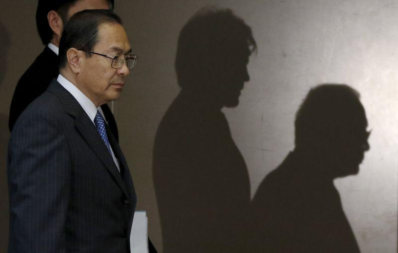 Toshiba Corp President and CEO Muromachi walks as he arrives at a round table meeting with reporters at the company headquarters in Tokyo