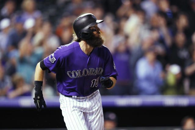 Colorado Rockies' Charlie Blackmon watches his walk-off solo home run off Houston Astros relief pitcher Collin McHugh during a baseball game Wednesday, July 25, 2018, in Denver. The Rockies won 3-2. (AP Photo/David Zalubowski)