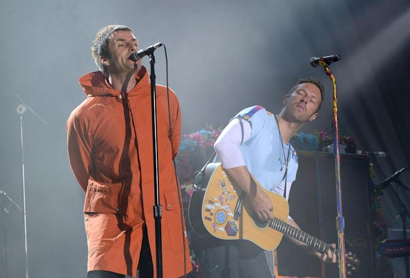 Liam Gallagher, here at the One Love concert with Chris Martin, is said to be stepping in for the sick singer. Source: Getty