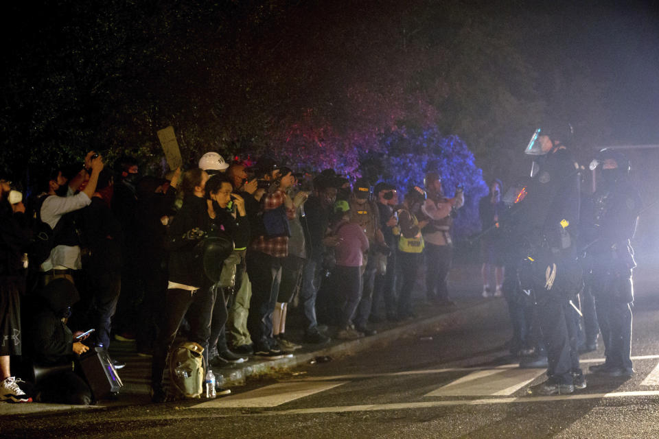 Demonstrators gathered at Floyd Light City Park on Thursday, Aug. 6, 2020 in Portland, Ore. State legislatures across the U.S. are pushing an array of policing reforms after the demonstrations related to the death of George Floyd last spring, from banning chokeholds to making it easier to hold officers legally accountable for their actions. (Mark Graves/The Oregonian via AP)