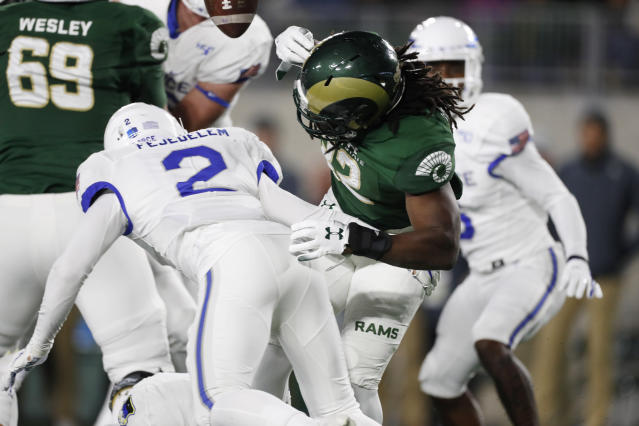Air Force defensive back Jeremy Fejedelem, left, knocks the ball out of the hands of Colorado State running back Marcus McElroy as he runs in the first half of an NCAA football game Saturday, Nov. 16, 2019 in Fort Collins, Colo. (AP Photo/David Zalubowski)