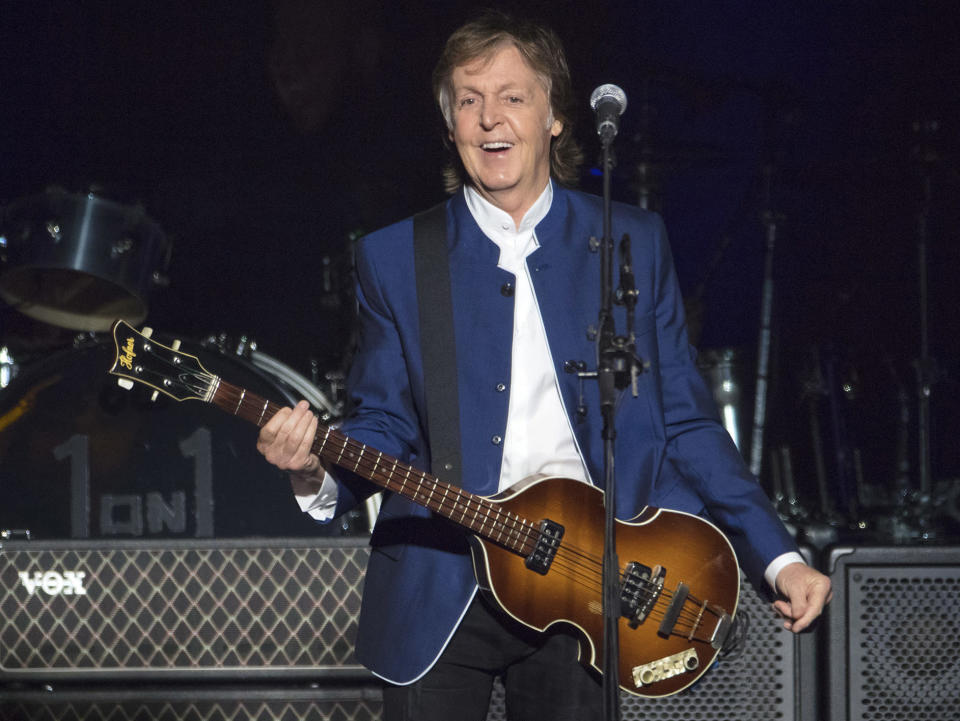 """FILE - In this Monday, July 10, 2017 file photo, Paul McCartney performs at Amalie Arena in Tampa, Fla. McCartney scored his 79th Grammy nominations this year — as an art director. The former Beatle is nominated for best boxed or special limited edition package for the collector's edition of his 10th solo album, """"Flaming Pie."""" He's listed as one of the art directors on the project, and shares his nomination with Linn Wie Andersen, Simon Earith and James Musgrave. (AP Photo/Scott Audette, FILE)"""