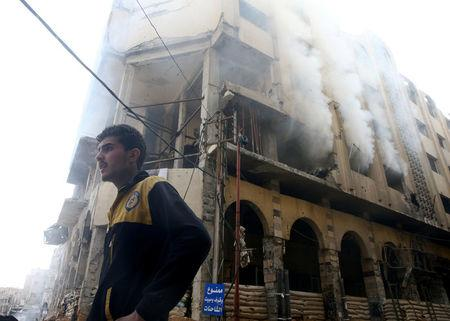 A smoke rises from a building after an airstrike in the besieged town of Douma, Eastern Ghouta, Damascus, Syria February 9, 2018. REUTERS/Bassam Khabieh