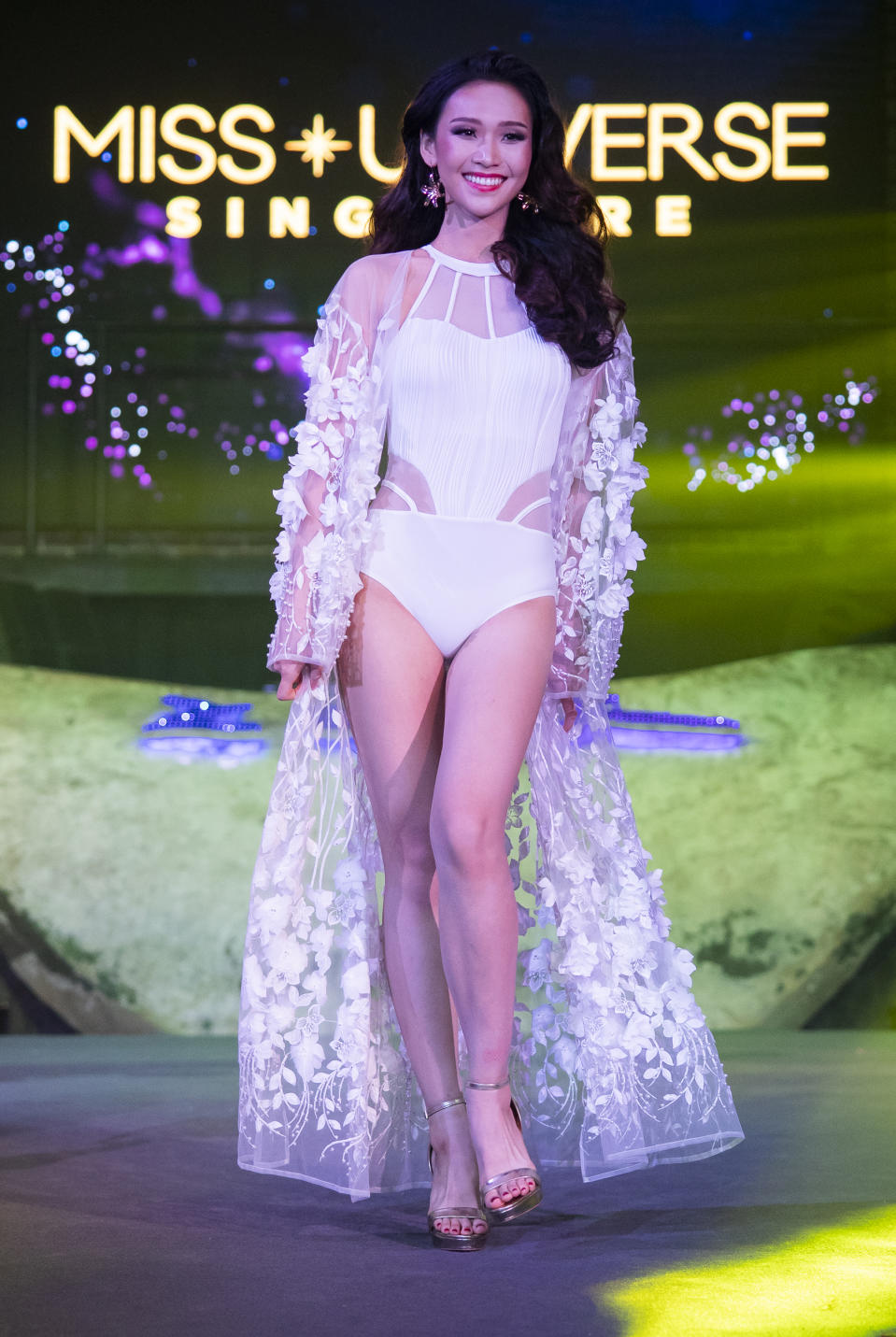 Lia Tan competing in the swimwear segment during the 2019 Miss Universe Singapore at Zouk.