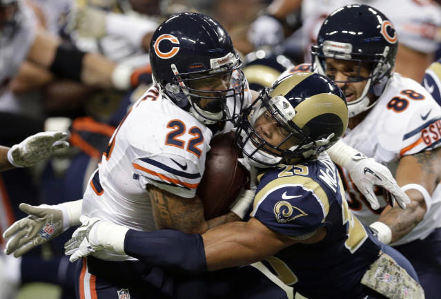 Chicago Bears running back Matt Forte, left, runs with the ball as he is pulled down by St. Louis Rams safety T.J. McDonald during the first quarter of an NFL football game on Sunday, Nov. 24, 2013, in St. Louis. (AP Photo/Nam Y. Huh)