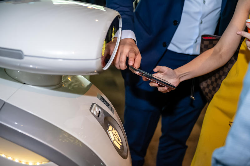 Members of the public are able to interact with the robot by scanning its QR code. (PHOTO: LionsBot)