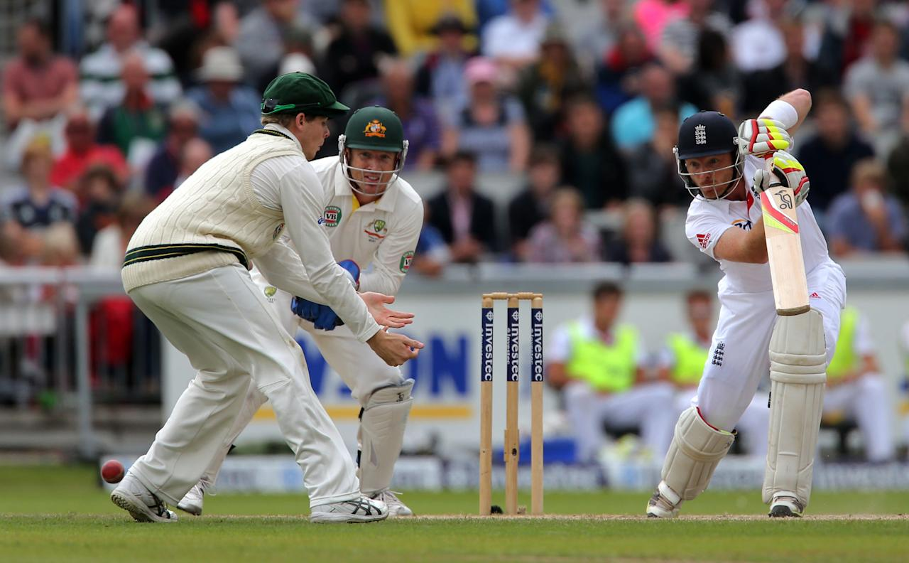 England's Ian Bell drives the ball past Steve Smith during the single over bowled by Australia captain Micheal Clarke during day five of the Third Investec Ashes test match at Old Trafford Cricket Ground, Manchester.