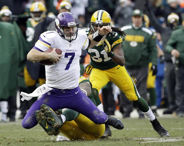 Minnesota Vikings quarterback Christian Ponder (7) is sacked by Green Bay Packers' Mike Neal during the second half of an NFL football game Sunday, Nov. 24, 2013, in Green Bay, Wis. The game ended in a tie, 26-26. (AP Photo/Jeffrey Phelps)