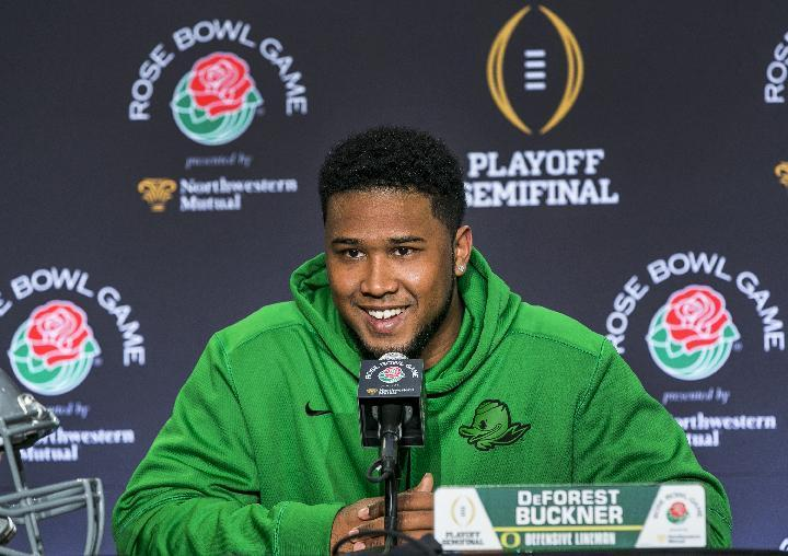 Oregon defensive lineman DeForest Buckner smiles as he takes questions during a news conference in Los Angeles, Sunday, Dec. 28, 2014. Oregon takes on Florida State in the Rose Bowl NCAA college football game on New Year's Day. (AP Photo/Damian Dovarganes)