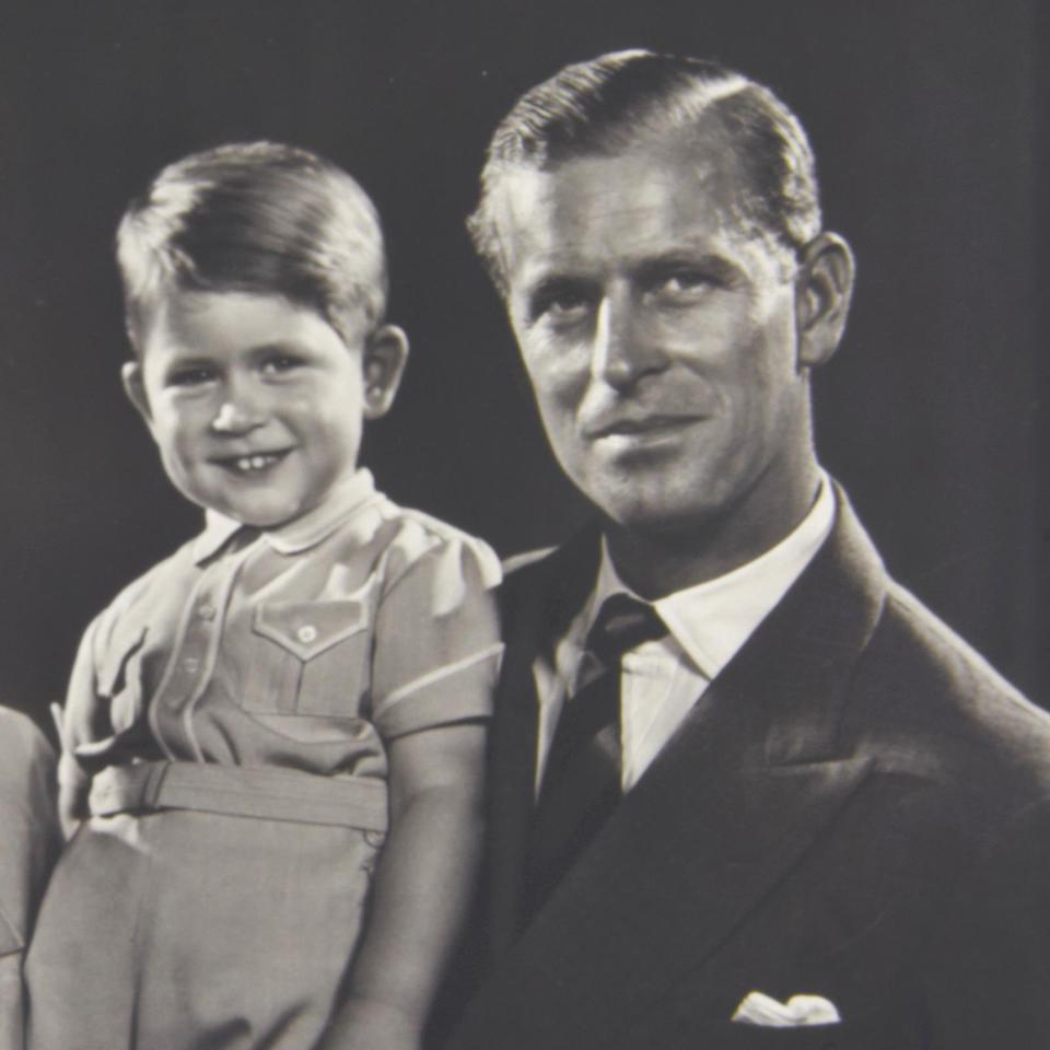 Prince Philip with a young Prince Charles.