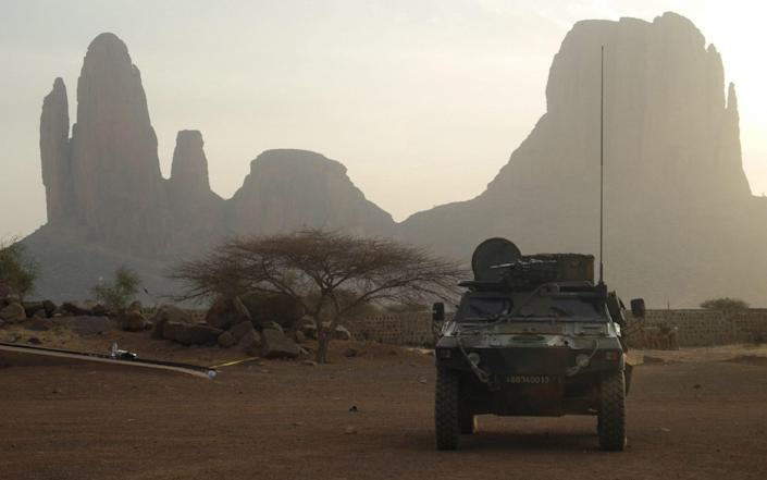 A French armoured vehicle drives by Mount Hombori in Mali in 2019 - DAPHNE BENOIT/AFP