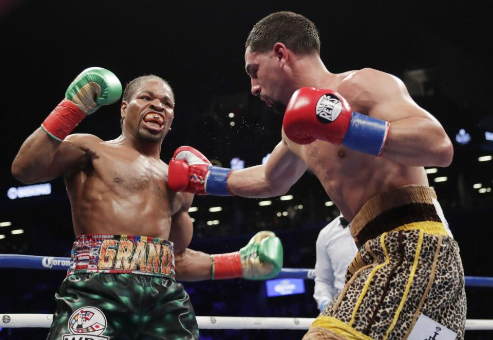 Shawn Porter (L) fights Danny Garcia during the seventh round of a WBC welterweight championship boxing match Saturday, Sept. 8, 2018, in New York. (AP Photo)