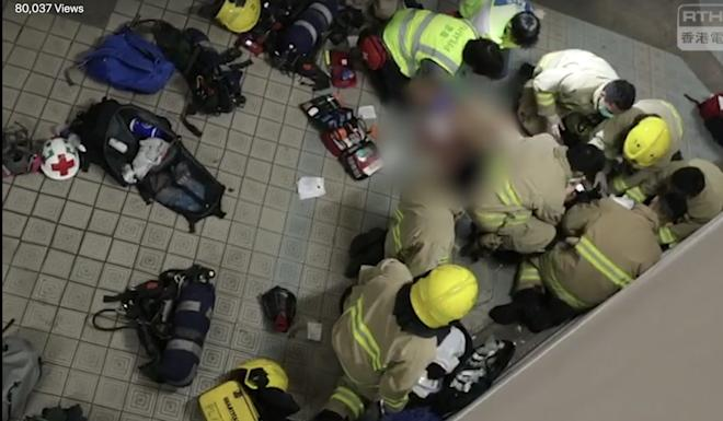 Medical staff respond after the student fell from the third floor to the second floor in a Tseung Kwan O car park on Sunday night. Photo: RTHK