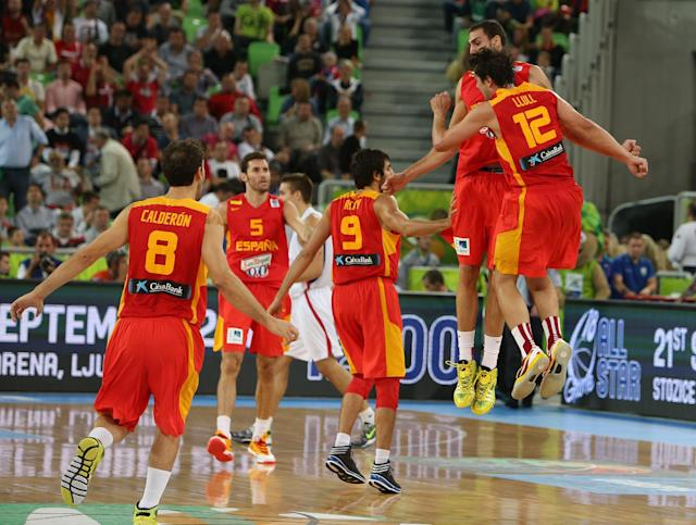 Spain's players celebrate a three-point shot in the last second of the first half of the EuroBasket European Basketball Championship quarterfinal match against Serbia at the Stozice Arena, in Ljubljana, Slovenia, Wednesday, Sept. 18, 2013. (AP Photo/Thanassis Stavrakis)