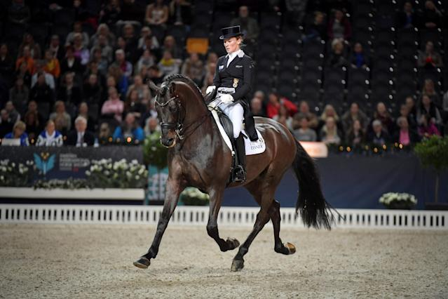 Equestrian - Sweden International Horse Show - Fei Grand Prix Dressage Qualification Event - Friends Arena, Stockholm, Sweden - December 2, 2017. Helen Langehanenberg of Germany rides her horse Damsey FRH. TT News Agency/Jessica Gow via REUTERS ATTENTION EDITORS - THIS IMAGE WAS PROVIDED BY A THIRD PARTY. SWEDEN OUT. NO COMMERCIAL OR EDITORIAL SALES IN SWEDEN