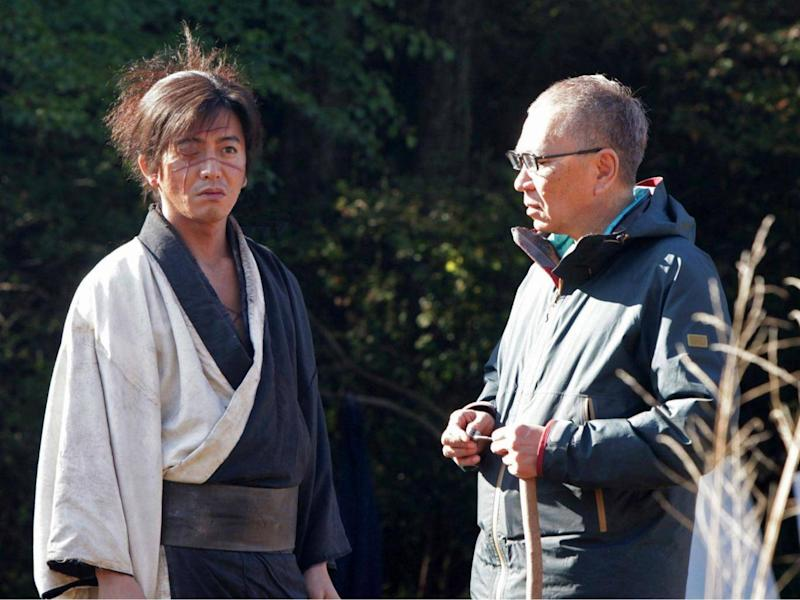 Director Miike (right) on set of 'Blade of the Immortal' with Takuya Kimura, who plays Manji