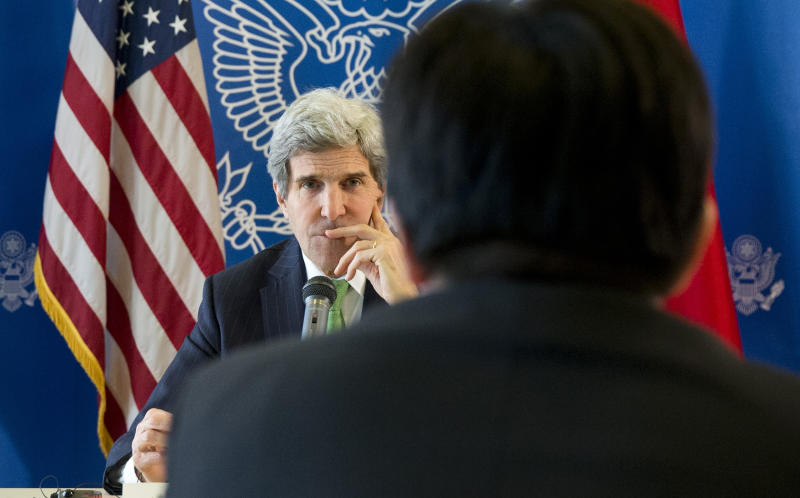 U.S. Secretary of State John Kerry, rear, listens to a question during a discussion with Chinese bloggers on a number of issues, including internet freedom, Chinese territorial disputes with Japan, North Korea, and human rights, on Saturday, Feb. 15, 2014, in Beijing, China. (AP Photo/Evan Vucci, Pool)