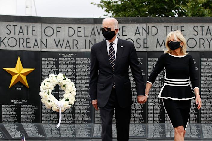 Joe Biden and his wife Jill wear face masks as they participate in a wreath-laying to mark Memorial Day at the Delaware Memorial Bridge Veterans Memorial Park in New Castle: AP