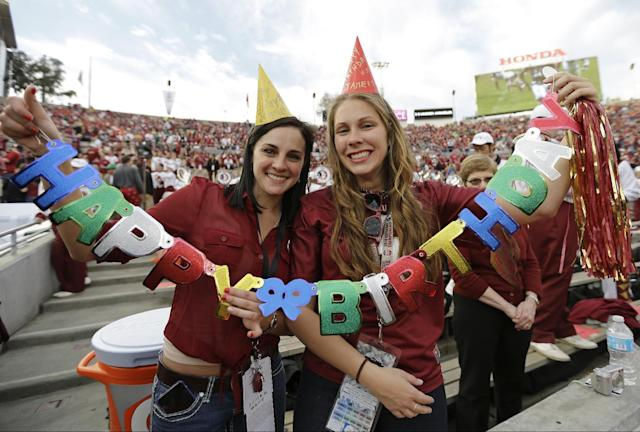 Francesca Corsini, left, and Rachel Johnson hold up a sign for Florida State's Jameis Winston before the NCAA BCS National Championship college football game against Auburn Monday, Jan. 6, 2014, in Pasadena, Calif. (AP Photo/David J. Phillip)