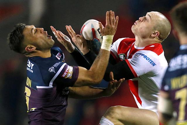 Rugby League - Super League - St. Helens vs Leeds Rhinos - Totally Wicked Stadium, St. Helens, Britain - March 16, 2018 Leeds Rhinos' Joel Moon and St Helens' Adam Swift in action Action Images/Ed Sykes TPX IMAGES OF THE DAY