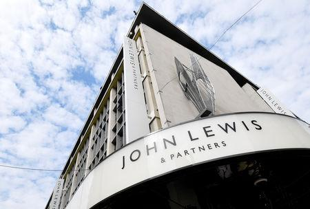 FILE PHOTO: Branding and signage is seen at the John Lewis and Partners retail store in Oxford Street, London, Britain, September 5, 2018. REUTERS/Toby Melville/File Photo