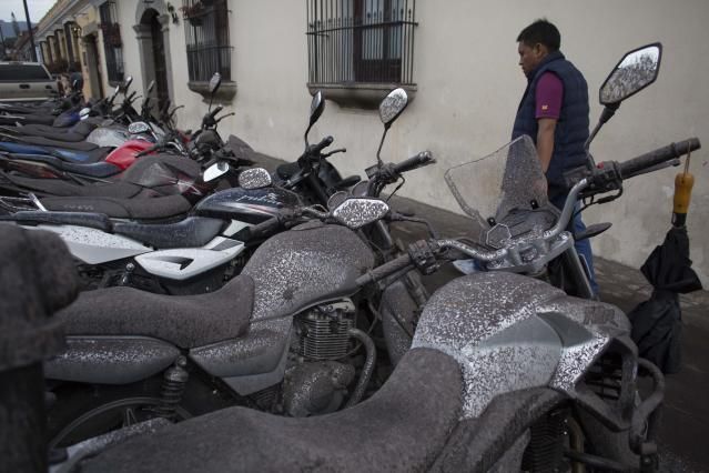 <p>Volcanic ash covers parked motorcycles, brought by the Fuego Volcano, in Antigua Guatemala, June 3, 2018. (Photo: Luis Soto/AP) </p>