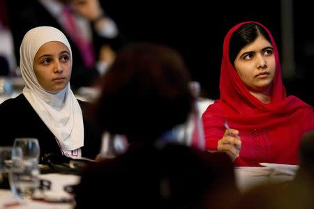 Nobel Peace Prize winner Malala Yousafzai (R) and 17-year-old Syrian refugee Mazoun Almellehan listen to speakers during the first focus event on education at the donors Conference for Syria in London, Britain February 4, 2016. REUTERS/Matt Dunham/pool