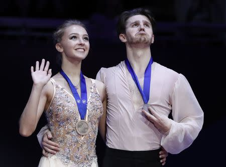 Figure Skating - ISU European Championships 2018 - Ice Dance Victory Ceremony - Moscow, Russia - January 20, 2018 - Bronze medallists Alexandra Stepanova and Ivan Bukin of Russia attend the ceremony. REUTERS/Grigory Dukor