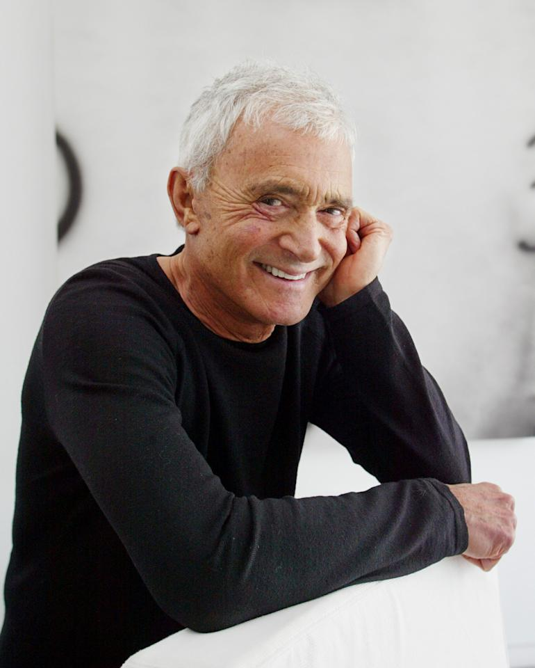 FILE - In this April 23, 2003 file photo, Vidal Sassoon poses in his Beverly Hills, Calif., home. Sassoon, whose 1960s wash-and-wear cuts freed women from endless teasing and hairspray died Wednesday, May 9, 2012, at his home. He was 84. (AP Photo/Damian Dovarganes, file)