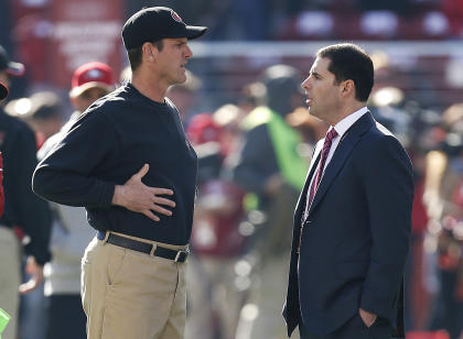 Jim Harbaugh (L) and San Francisco 49ers owner Jed York decided to mutually part ways on Sunday. (AP)