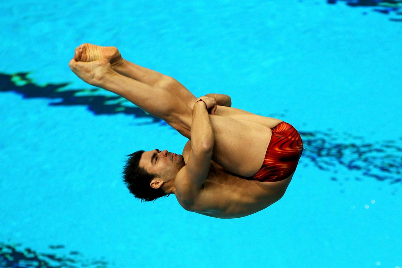 DELHI, INDIA - OCTOBER 11:  Alexandre Despatie of Canada competes in the Men's 3m Springboard Preliminary at Dr. S.P. Mukherjee Aquatics Complex during day eight of the Delhi 2010 Commonwealth Games on October 11, 2010 in Delhi, India.  (Photo by Phil Walter/Getty Images)