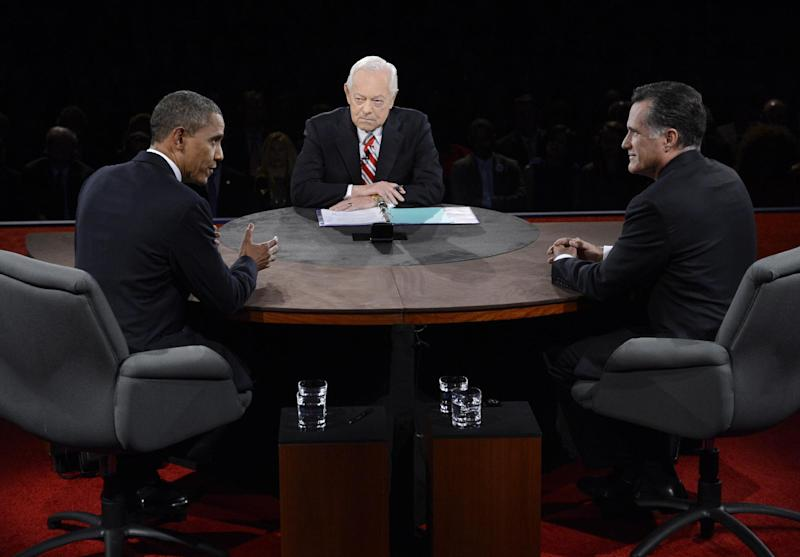 President Barack Obama speaks as Republican presidential nominee Mitt Romney and moderator Bob Schieffer listen during the third presidential debate at Lynn University, Monday, Oct. 22, 2012, in Boca Raton, Fla. (AP Photo/Pool-Michael Reynolds)