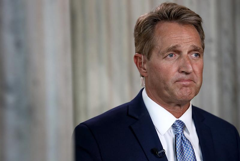 "Sen. Jeff Flake (R-Ariz.) looking sad, after he announced he's not running for re-election. He said he's bowing out because he can no longer be ""complicit"" with what President Donald Trump is doing to the country. (Win McNamee via Getty Images)"