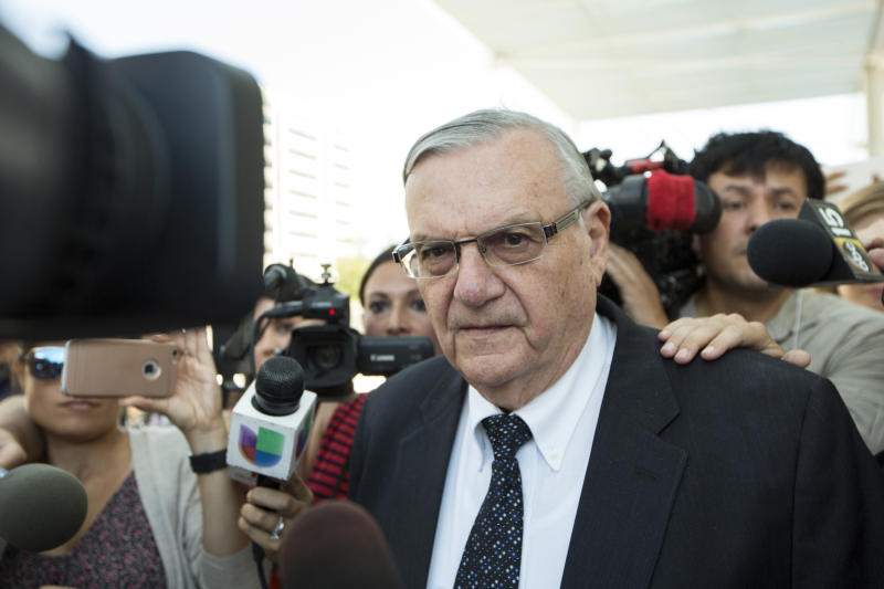 FILE- In this July 6, 2017, file photo, former Sheriff Joe Arpaio leaves the federal courthouse in Phoenix, Ariz. Arpaio, who was pardoned by President Donald Trump from his federal contempt-of-court conviction in an immigration case is experiencing a wobbly return to the public speaking circuit. In Las Vegas, security concerns prompted event planners to move Arpaio's scheduled weekend appearance to an undisclosed location away from the casino-lined Strip tourist district. (AP Photo/Angie Wang, File)