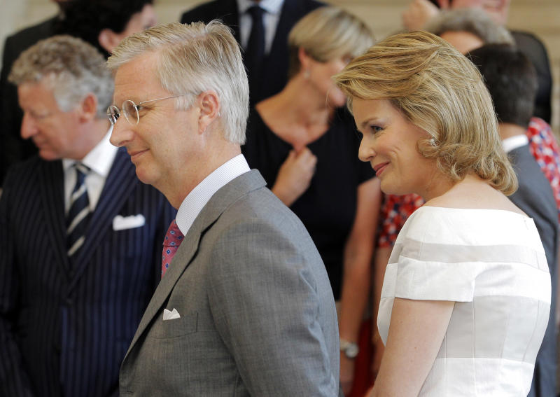 Belgian Crown Prince Philippe, left, and his wife Mathilde, attend a photo call with the Belgian federal government prior to a farewell lunch at the Royal Palace in Laeken near Brussels, Monday, July 15, 2013. Belgian King Albert will abdicate in favor of Crown Prince Philippe on July 21. (AP Photo/Yves Logghe)