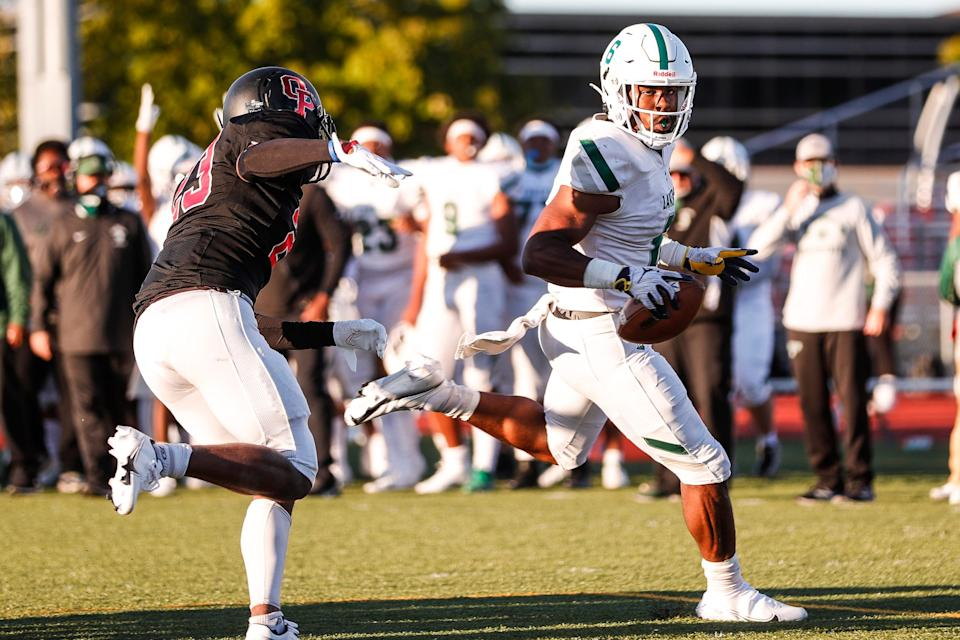 West Bloomfield running back Donovan Edwards runs against Oak Park  during the first half of season opener at Oak Park High School on Friday, Sept. 18, 2020.