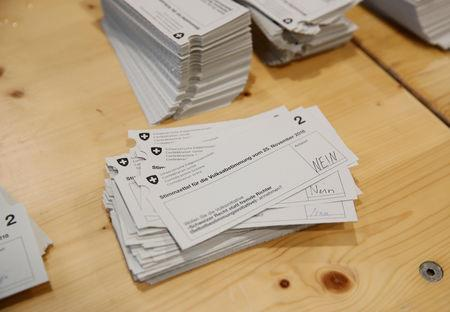 Ballot papers are seen at the district election office Stadtkreis 3 in Zurich, Switzerland November 25, 2018.   REUTERS/Arnd Wiegmann