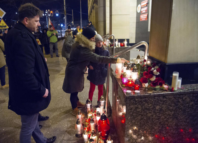People place candles as they mourn the mayor of Gdansk, Pawel Adamowicz, in Gdansk, Poland, Monday Jan. 14, 2019. Poland's president says a national day of mourning will be observed when a mayor who was fatally stabbed at a charity event is buried. President Andrzej Duda opened a news conference with a minute of silence in memory of Adamowicz, who died Monday from the stab wounds he suffered on Sunday night. (AP Photo/Wojciech Strozyk)