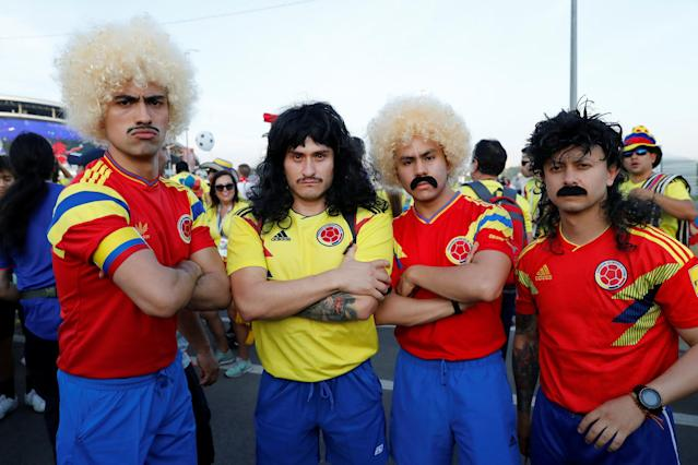 Soccer Football - World Cup - Group H - Poland vs Colombia - Kazan Arena, Kazan, Russia - June 24, 2018 Colombia fans wearing wigs outside the stadium before the match REUTERS/Jorge Silva