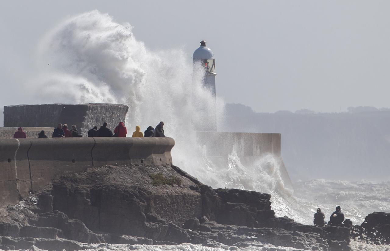 <p>Waves break over the coastline at Porthcawl in Wales, as Storm Aileen brings howling gusts and heavy showers to parts of the UK. (PA) </p>